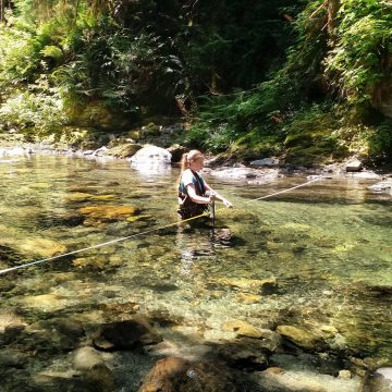 Kyra Freeman estimates streamflow with the USGS stream gauging method in the Upper North Fork Stillaguamish River