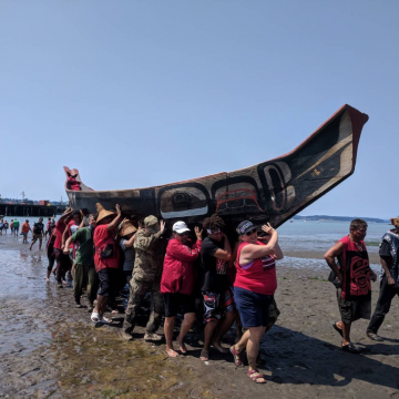Power Paddle to Puyallup, 2018. After landing, each canoe was carried above the high tide line by up to 50 volunteers.