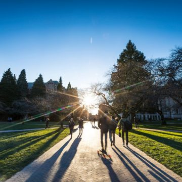 Students walk through the UW Quad in January