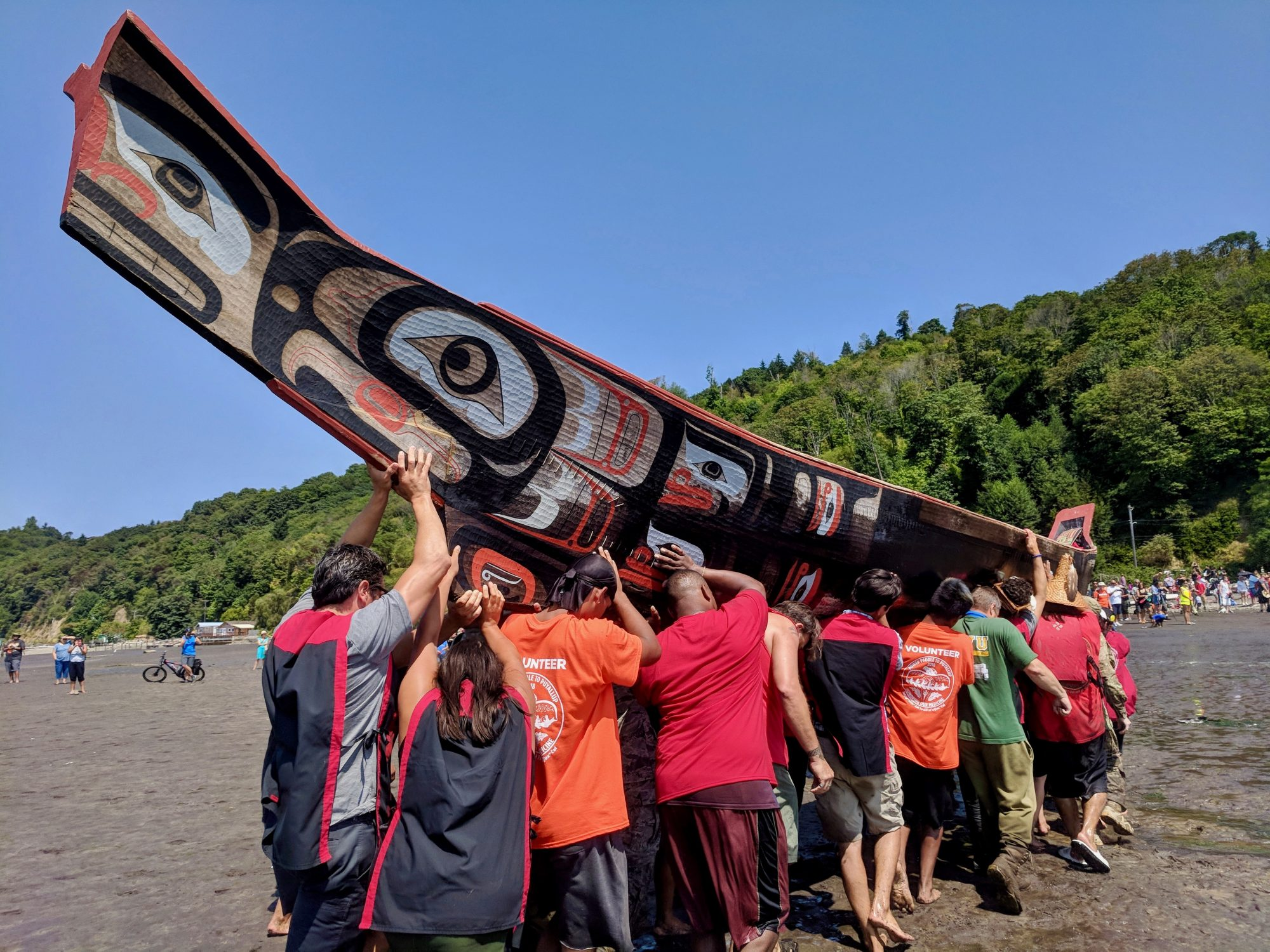 Power Paddle to Puyallup Tribal Canoe Journey, 2018. After landing, each canoe was carried above the high tide line by up to 50 volunteers.