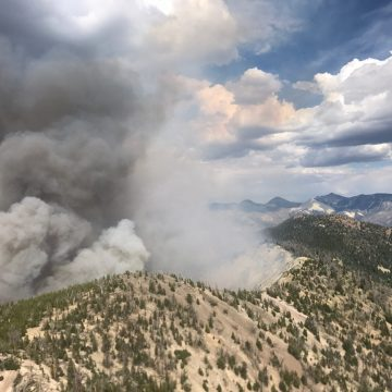 Smoke billows from a forested ridge during the 2017 Ibex Fire